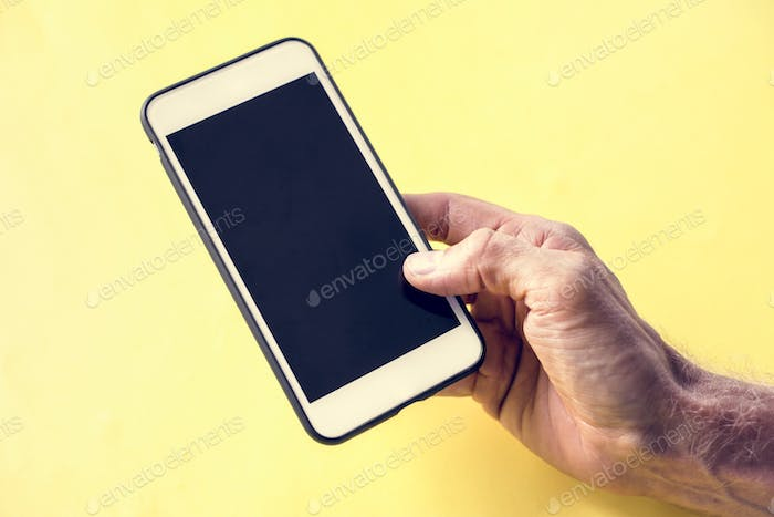 Hand holding smartphone isolated on background