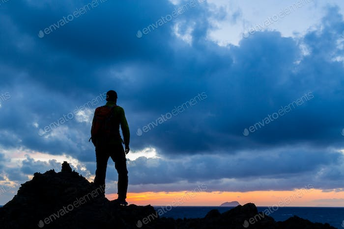 Hiking silhouette backpacker, inspirational sunset landscape