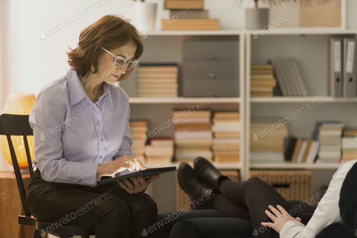 Personal life coach using tablet