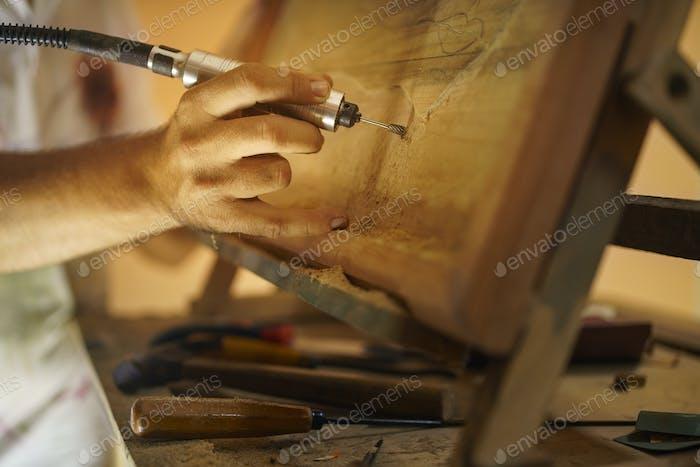 Sculptor Painter Artist Chiseling A Wooden Bas Relief