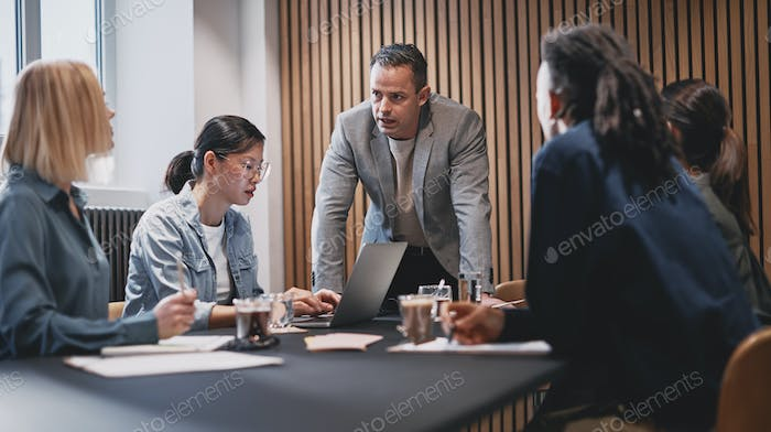Businessman discussing work with colleagues during a meeting
