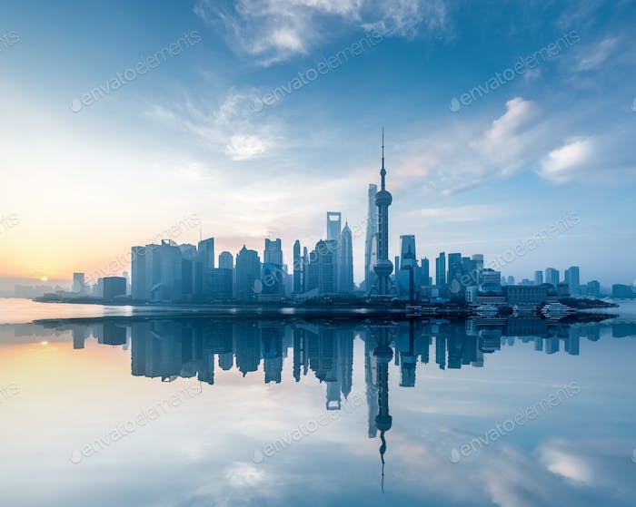 shanghai skyline with reflection in sunrise