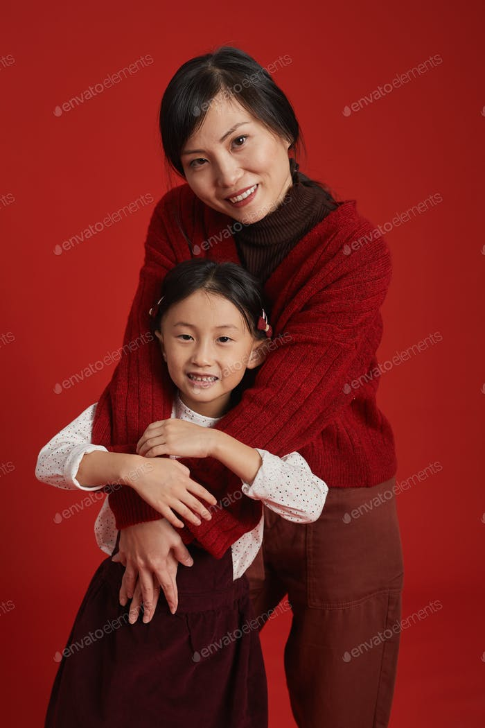 Happy Mother Hugging Daughter
