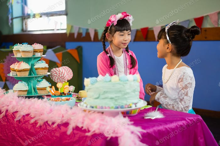 Friends interacting with each other during birthday party