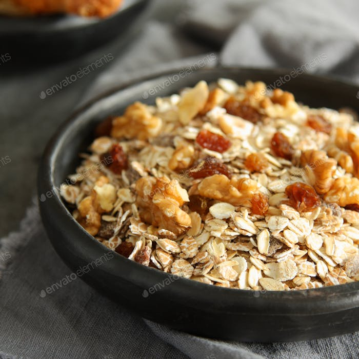 Healthy homemade granola on gray background
