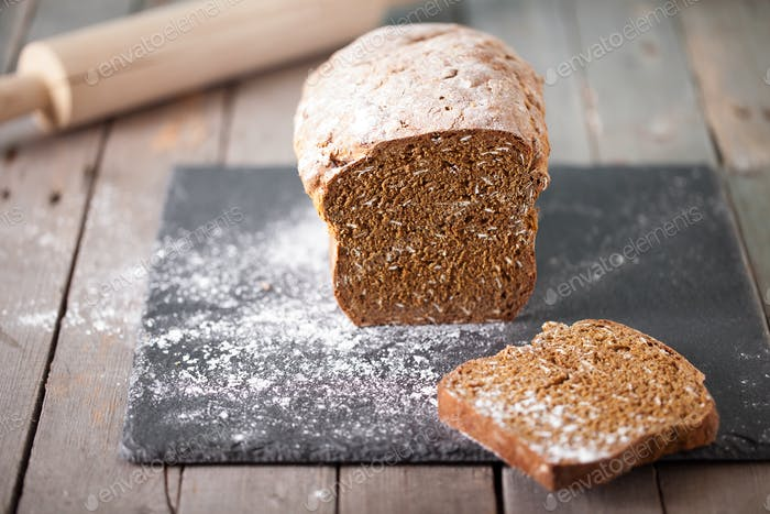 Fresh Irish soda bread with oat sliced on a slate cutting board Selective focus