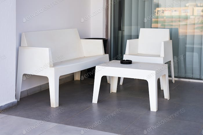 white modern chairs and table outdoors