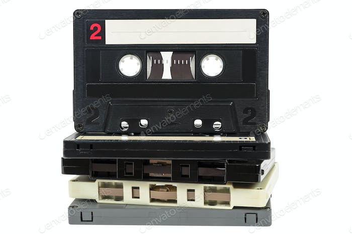 Stack of vintage audio tapes on white background