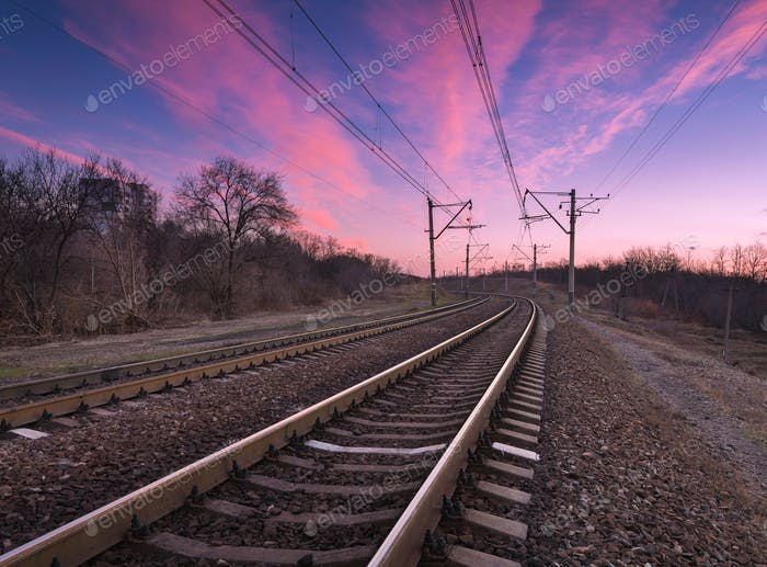 Railway station with beautiful sky at colorful sunset