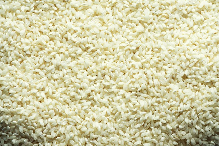 White raw organic basmati rice background. Food ingredient background. Top view, healthy lifestyle