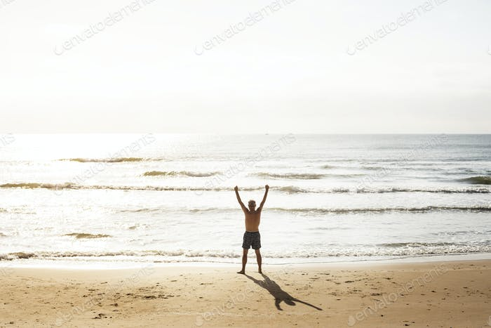Senior caucasian man standing at the beach