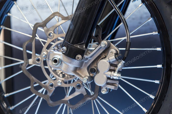 Detail of a motorcycle brake disc and caliper