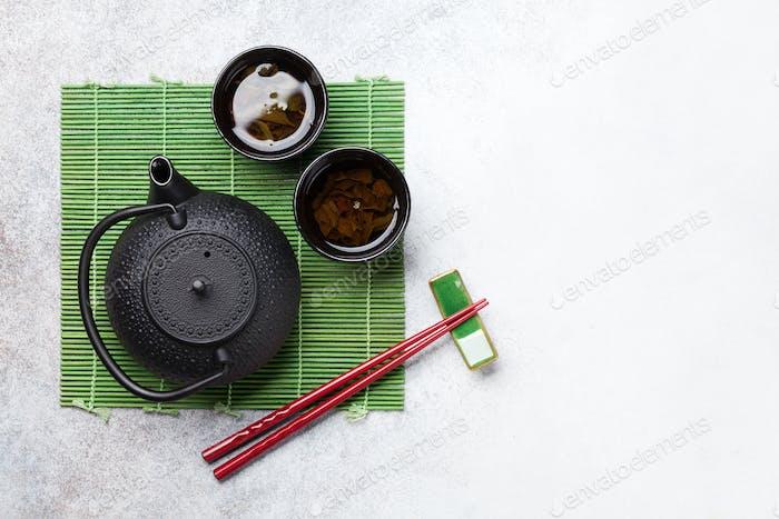 Green tea and sushi chopsticks. Japanese meal set