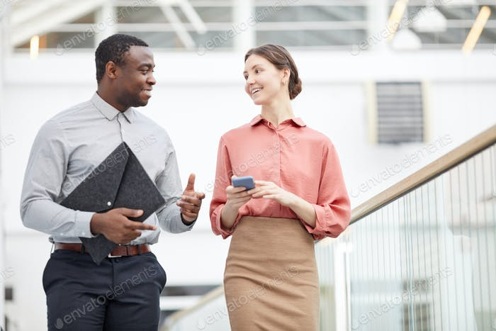 Smiling Business People Walking in Office Building