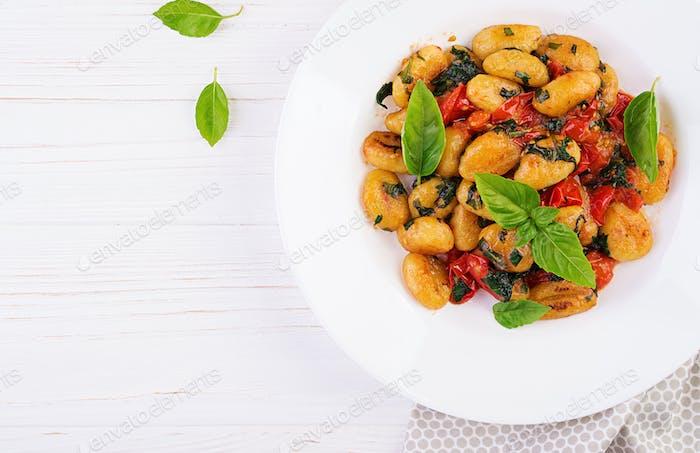 Gnocchi pasta in rustic style.  Italian cuisine. Vegetarian vegetable pasta.