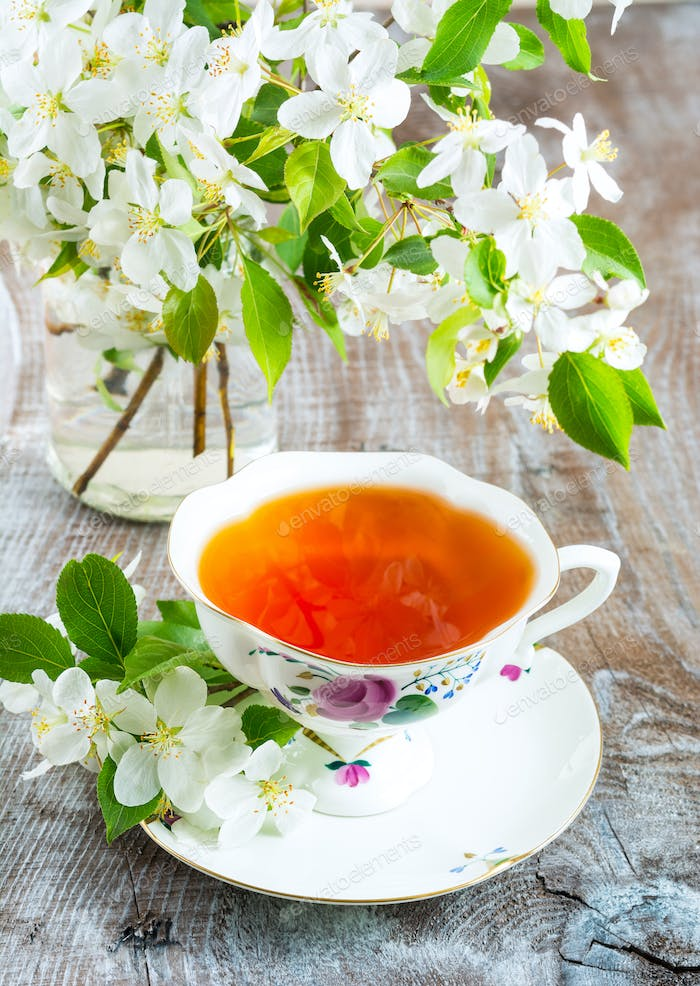 Cup of tea with apple blossom