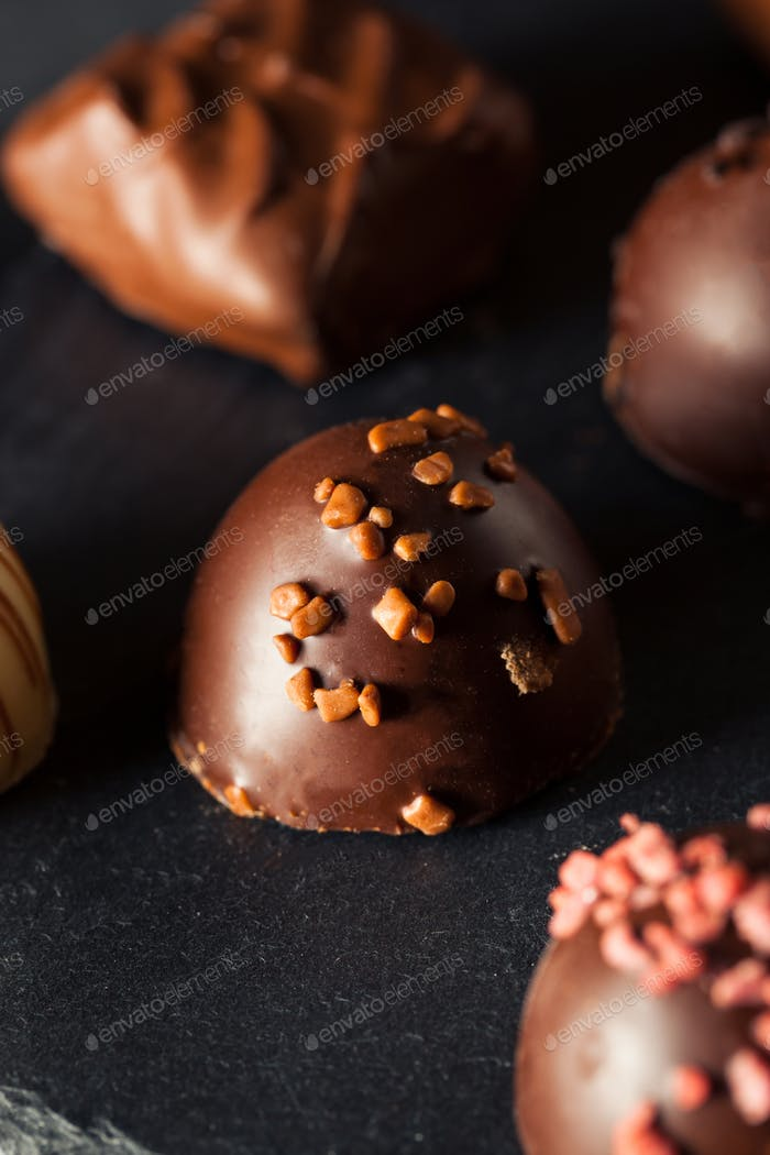 Homemade Dark Chocolate Truffles photo by bhofack2 on Envato Elements
