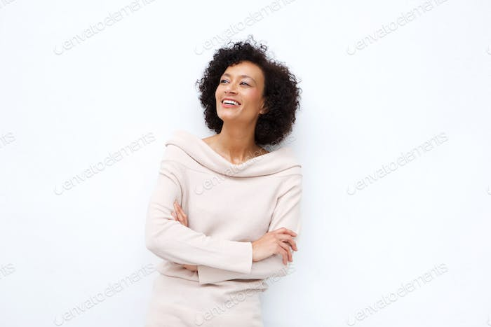 middle age woman smiling with arms crossed against white background