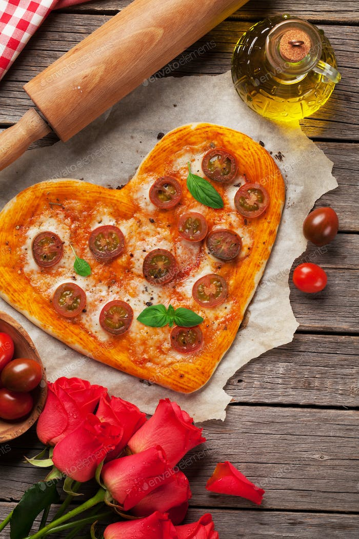Heart shaped pizza with tomatoes and mozzarella