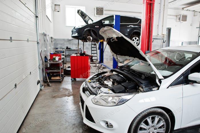 Сar in maintenance at garage service station.