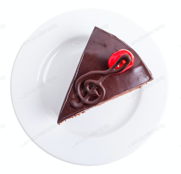 Delicious chocolate cake with cocktail cherry.