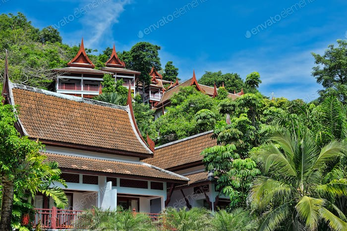 Thai Villa in the jungle against the sky