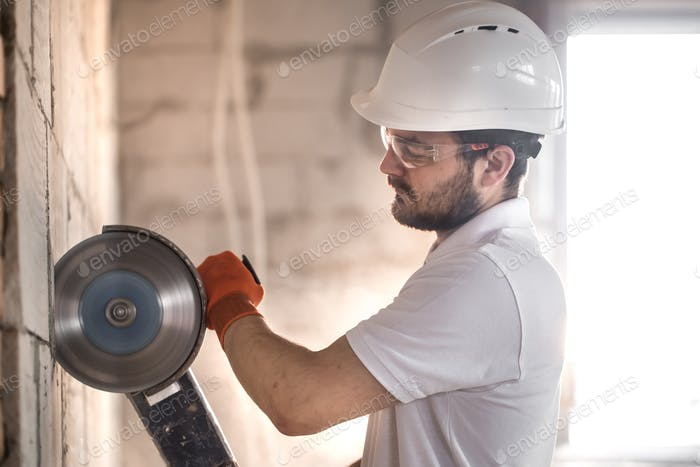 The industrial Builder works with a professional angle grinder.