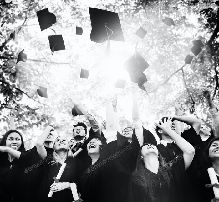 Diverse graduates throwing hats in the air