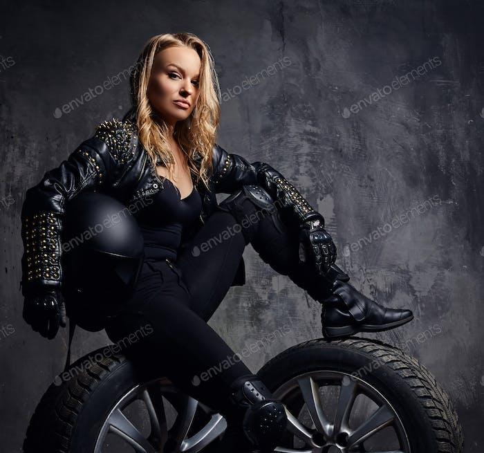 Fashion, sport, extreme. Sensual woman wearing racer costume