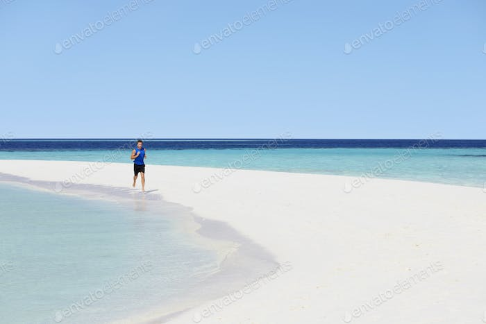 Man Running On Beautiful Beach