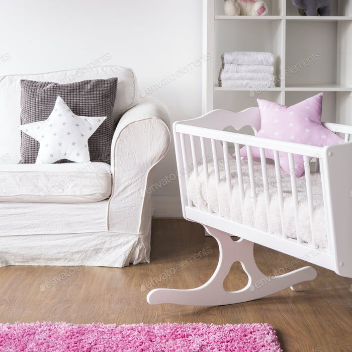 Bright nursery room with cradle