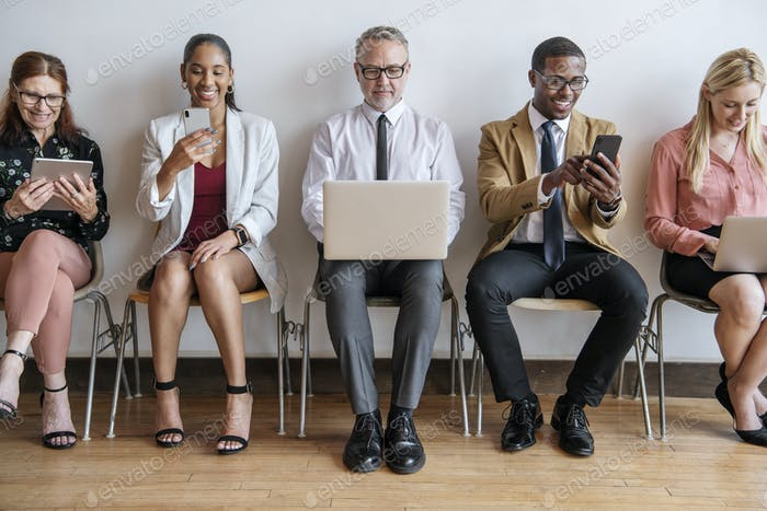 Diverse business people using digital devices