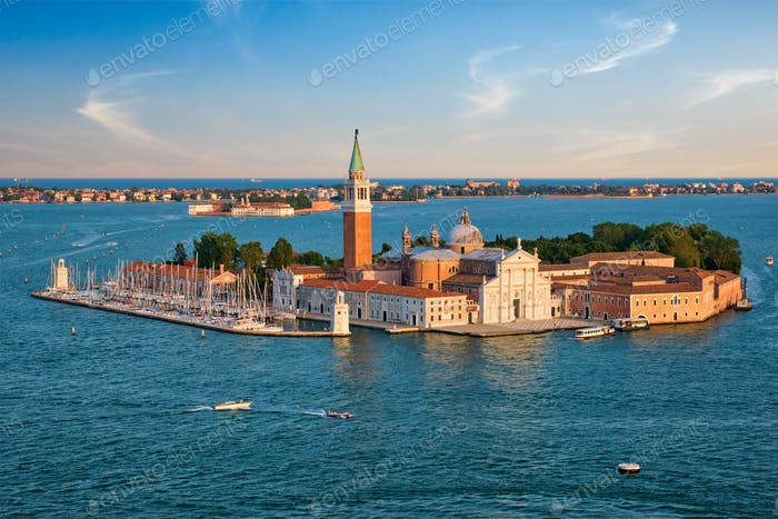 Aerial view of Venice lagoon with boats and San Giorgio di Maggiore church. Venice, Italy