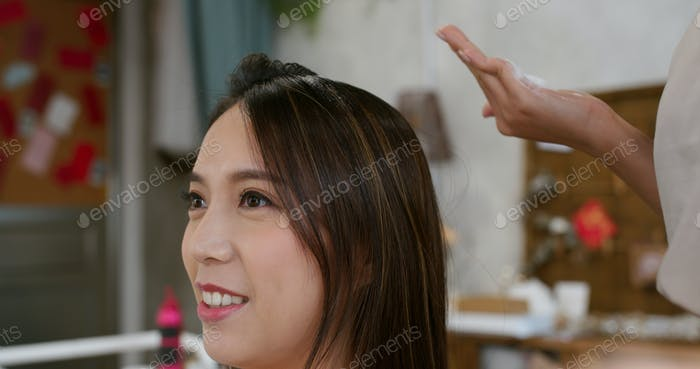 Make up artist make a hairstyle for bride in salon