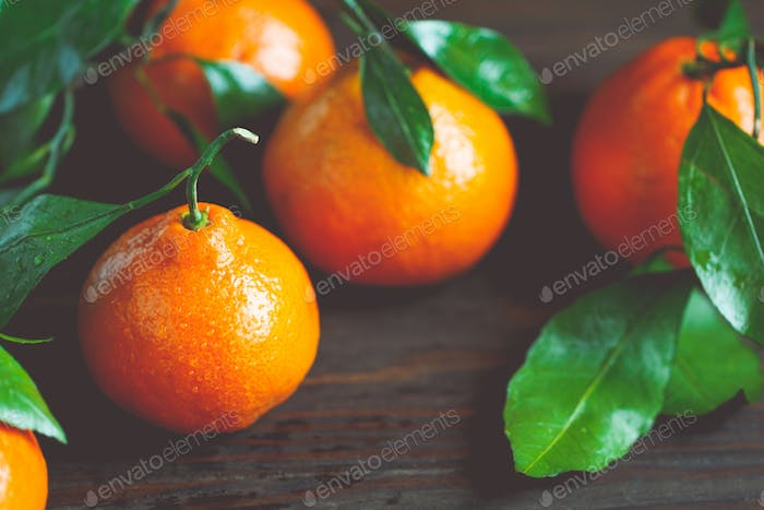 Tasty tangerines on a table. Macro food photography. The concept of healthy eating and lifestyle.