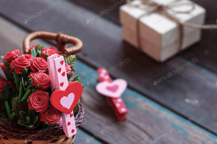 Heart-shaped in basket on wooden
