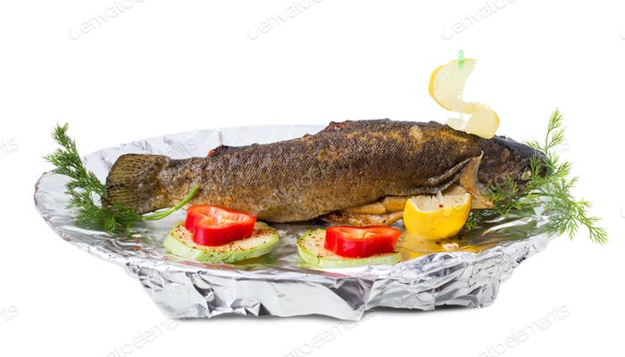 Delicious grilled trout with vegetables.
