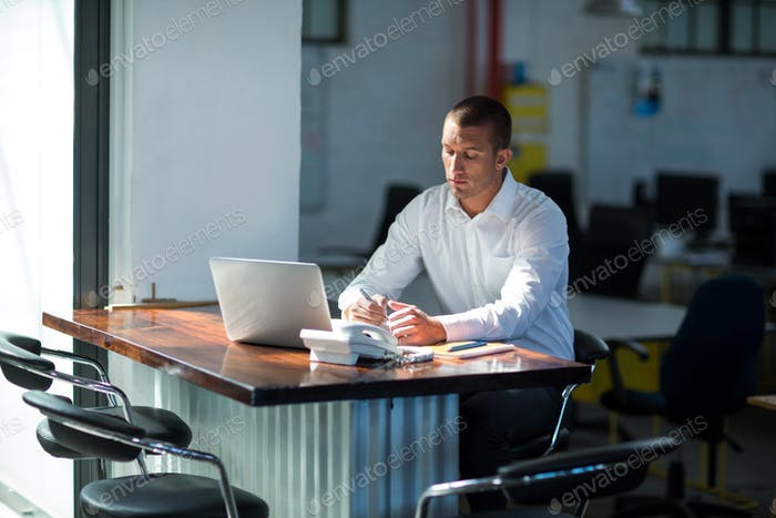 Attentive businessman working at desk