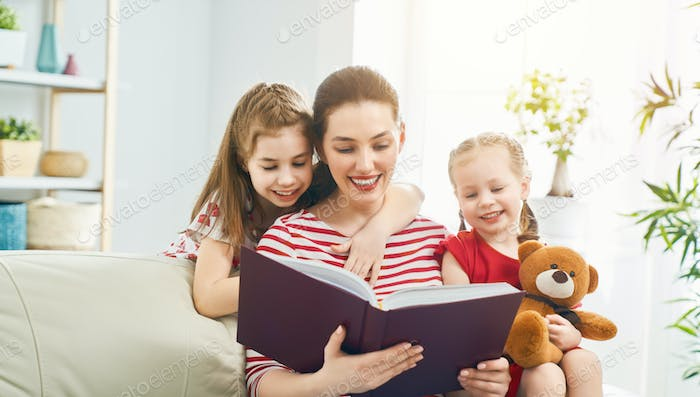 Thumbnail for mother reading a book to her daughters