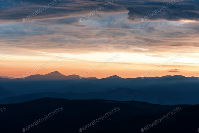 Picturesque summer landscape with colorful sunrise