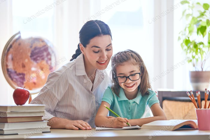 Mother and daughter are learning to write