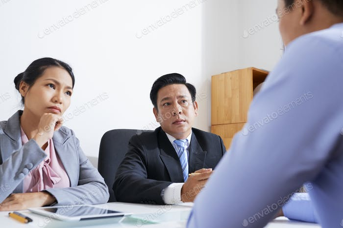 Entreprneurs talking to employee