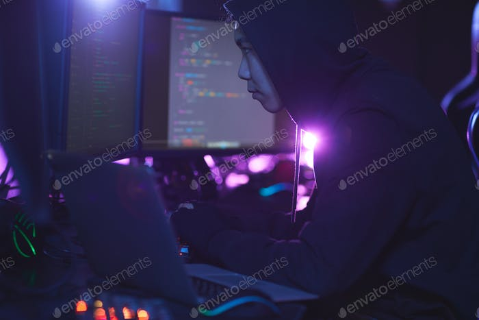 Asian Hacker in Dark