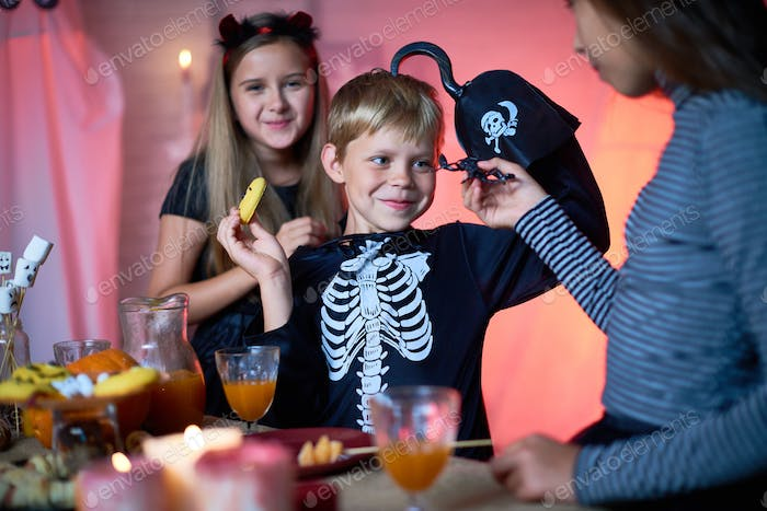 Cheerful kids having fun at Halloween party
