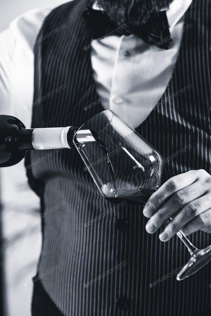 Pouring red wine from bottle