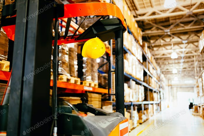 Picture of forklift machine parked in warehouse