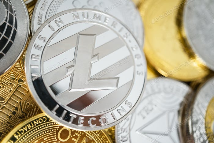 Close-Up of Litecoin Physical Coin On Stack of Many Other Cryptocurrencies