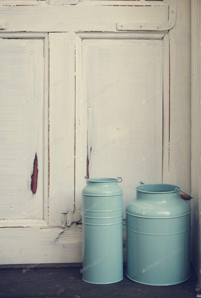 Vintage milk canisters.