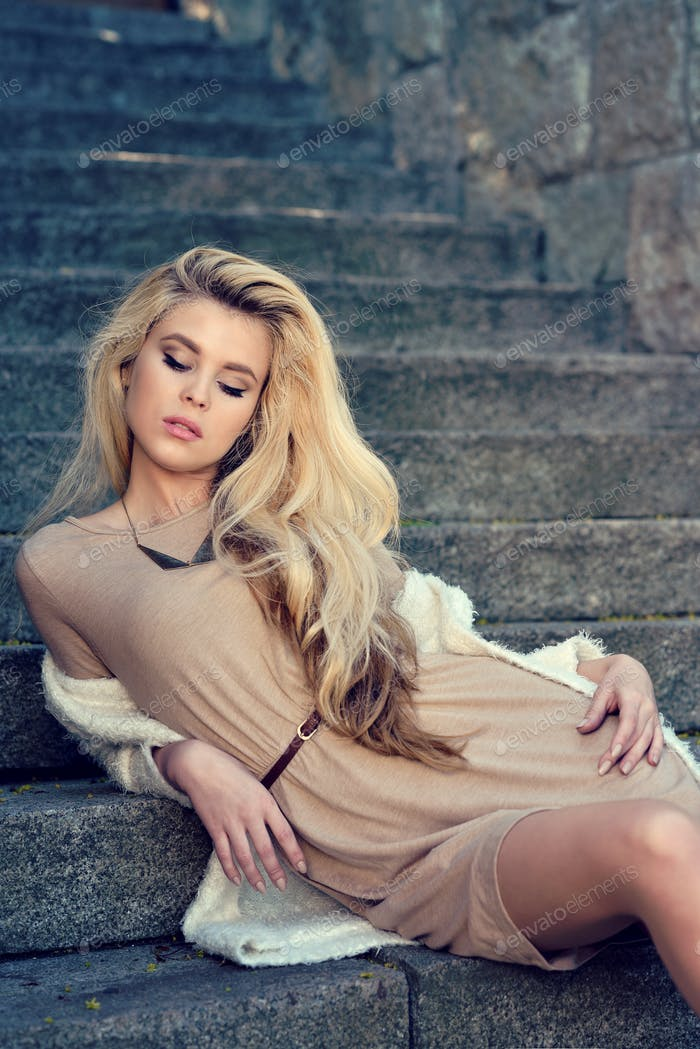 Fashionable portrait of lady with long hair in city