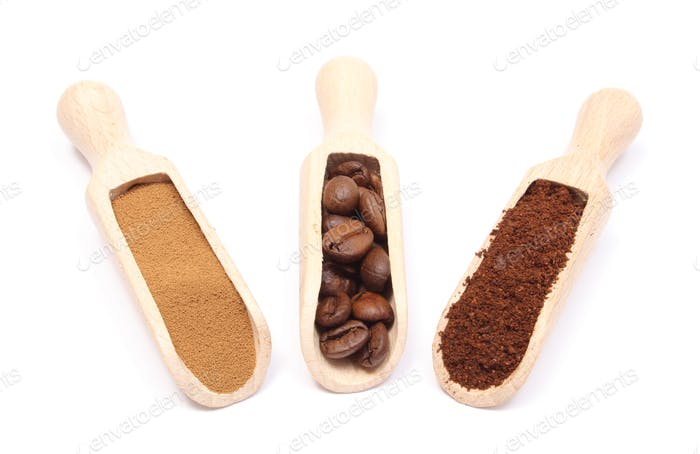 Grains, ground and instant coffee on wooden spoon